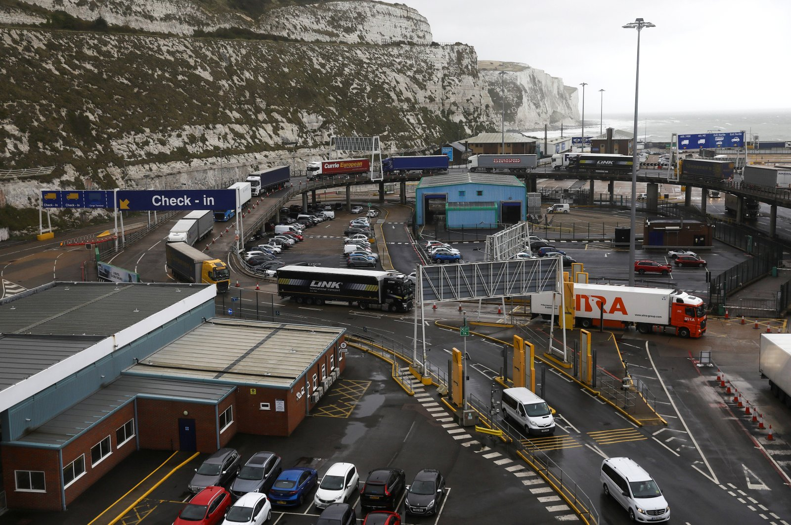 Freight trucks move through the terminal at the Port of Dover, Britain, Oct. 11, 2019. (Reuter Photo)