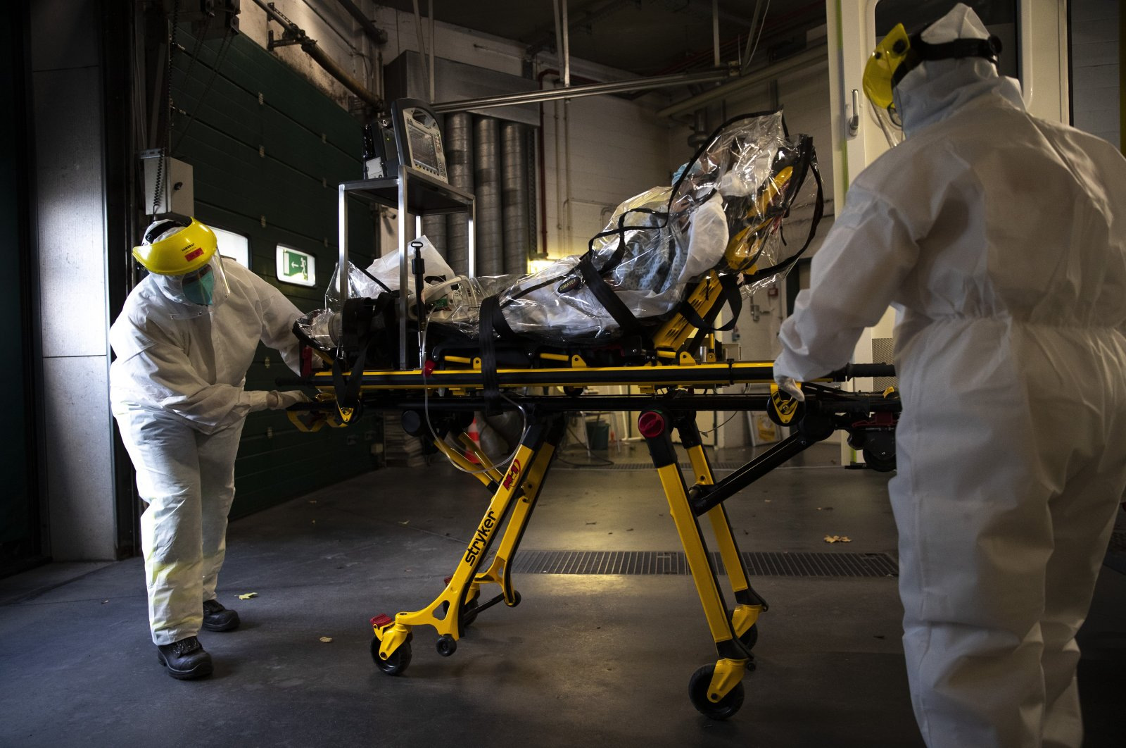 Medical staff transfer a COVID-19 patient from the CHR Citadelle hospital in Liege, Belgium, Oct. 21, 2020. (AP Photo)