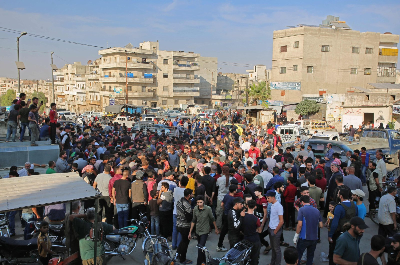 Syrians take part in the funeral of soldiers of the Faylaq al-Sham opposition faction in Syria, in the northwestern city of Idlib, on October 26, 2020, following their death in a Russian air strike. (AFP Photo)