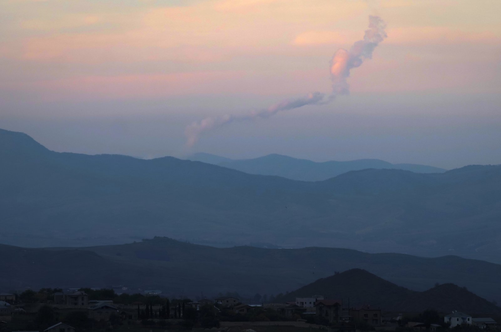 Smoke rises during fighting between Armenian and Azerbaijan's forces in the Karabakh mountains, Oct. 23, 2020. (AP Photo)