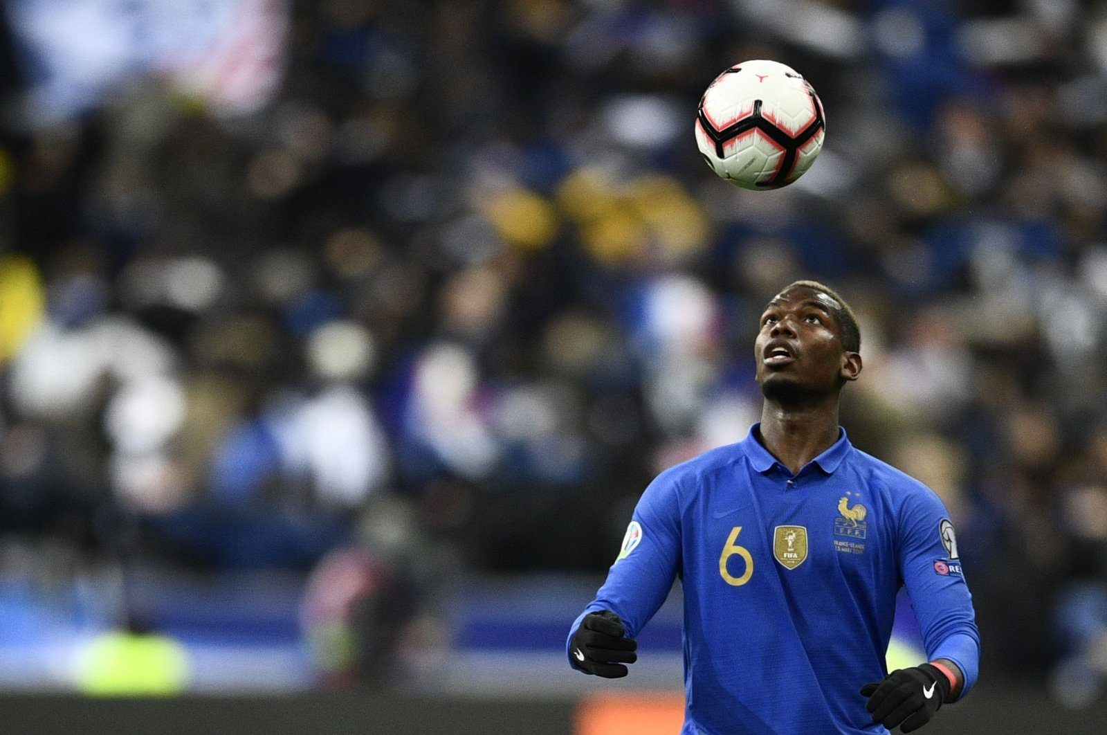 France's Paul Pogba heading a ball during a Euro 2020 match against Iceland, in Paris, France, March 25, 2019. (AFP Photo)