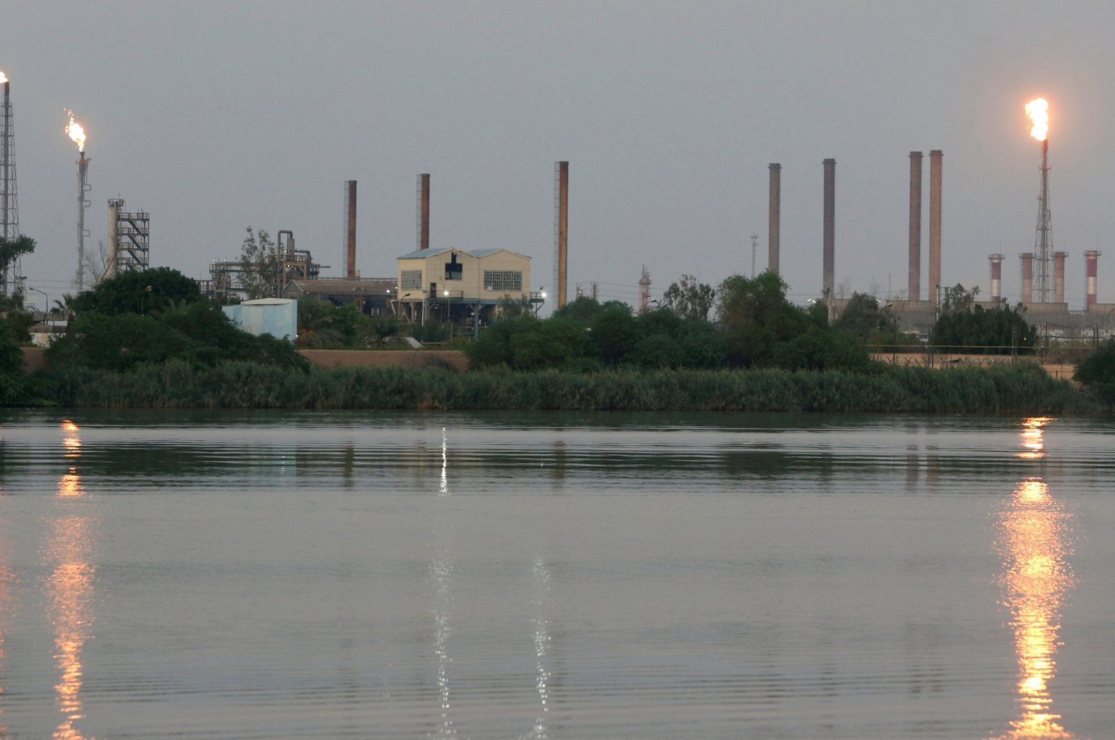 A general view of Abadan oil refinery in southwest Iran, is pictured from Iraqi side of Shatt al-Arab in Al-Faw south of Basra, Iraq September 21, 2019. (Reuters Photo)
