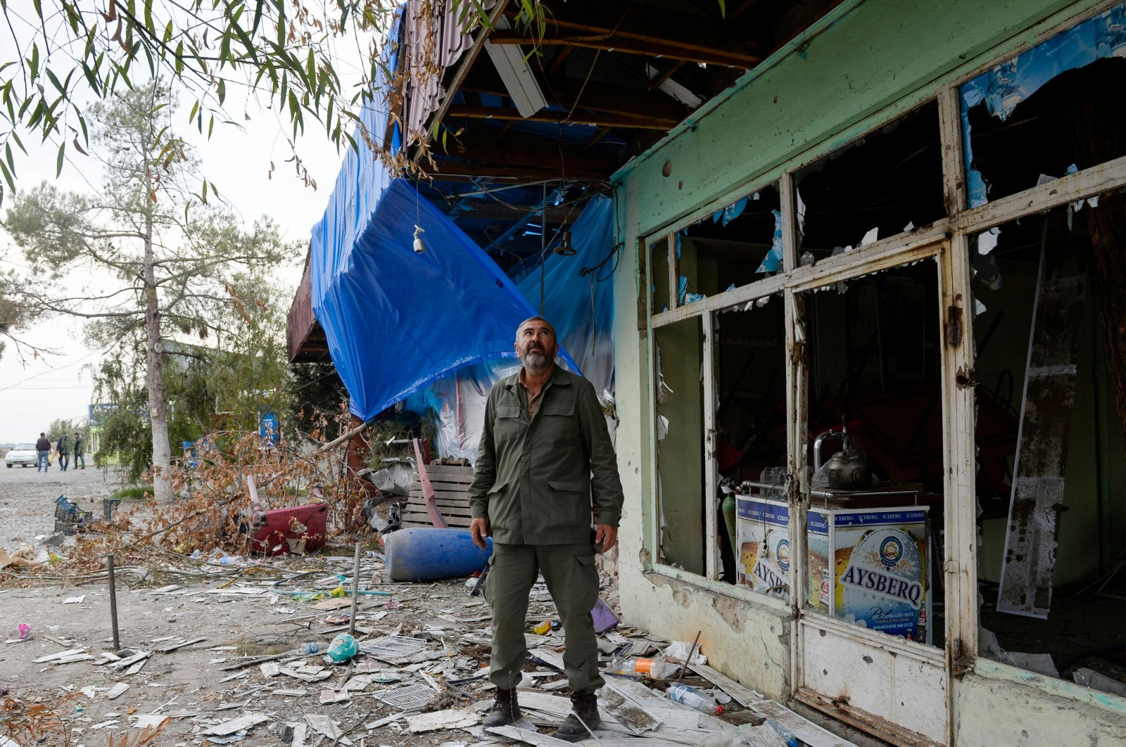 Local resident Rovshan stands by a cafe damaged by shelling in the settlement of Dord Yol in Azerbaijan's Tartar district on Oct. 26, 2020. (AFP Photo)