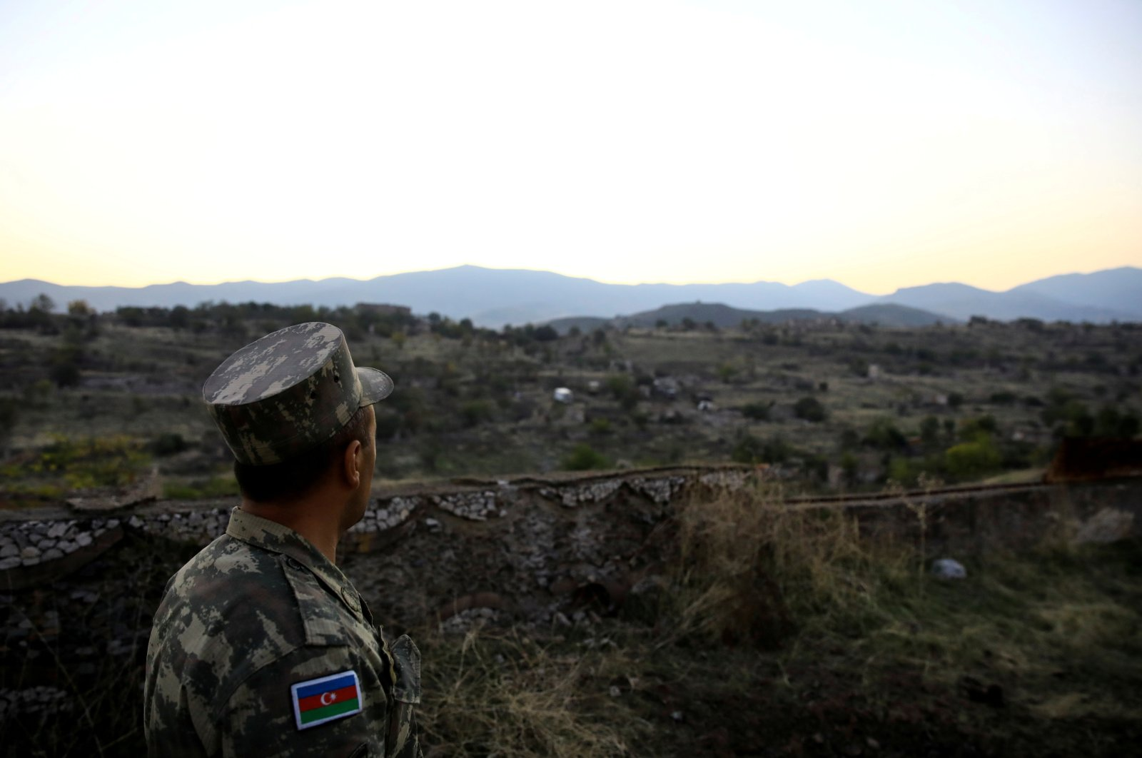 An Azerbaijani soldier inspects the city of Cebrayil, where Azerbaijani forces regained control during the fighting over the illegally occupied region of Nagorno-Karabakh, Azerbaijan October 16, 2020. (Reuters Photo)