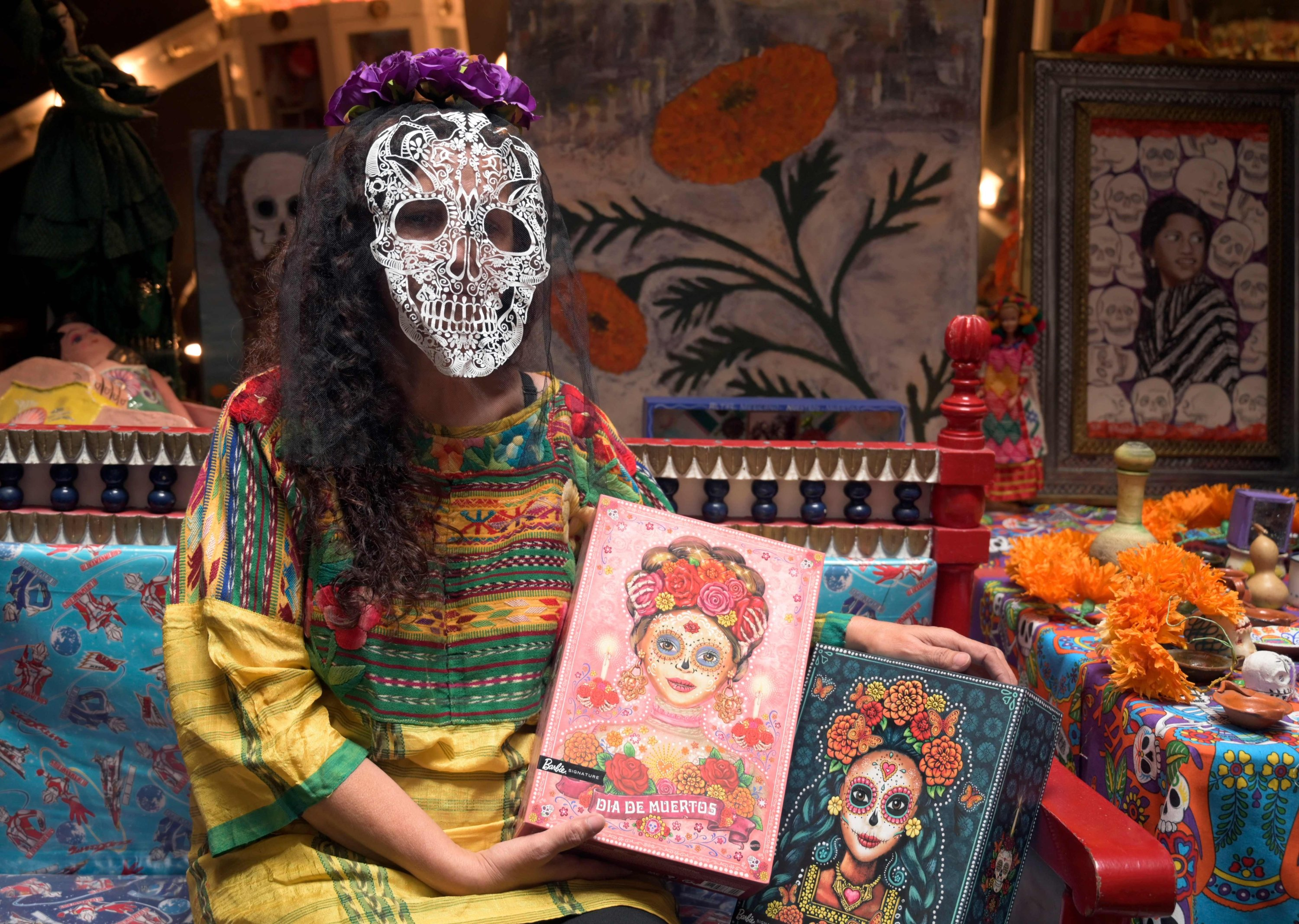 Mexican doll collector Zoila Muntane poses with two 'Catrina' Barbie doll boxes at the Museum of the Old Mexican Toy in Mexico City, Oct. 20, 2020. (AFP Photo)