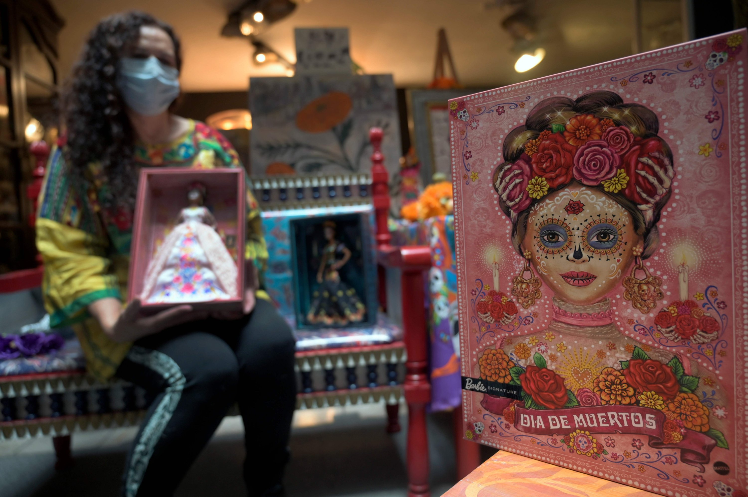 """Mexican doll collector Zoila Muntane poses with a """"Catrina"""" Barbie doll at the Museum of the Old Mexican Toy in Mexico City, Oct. 20, 2020. (AFP Photo)"""