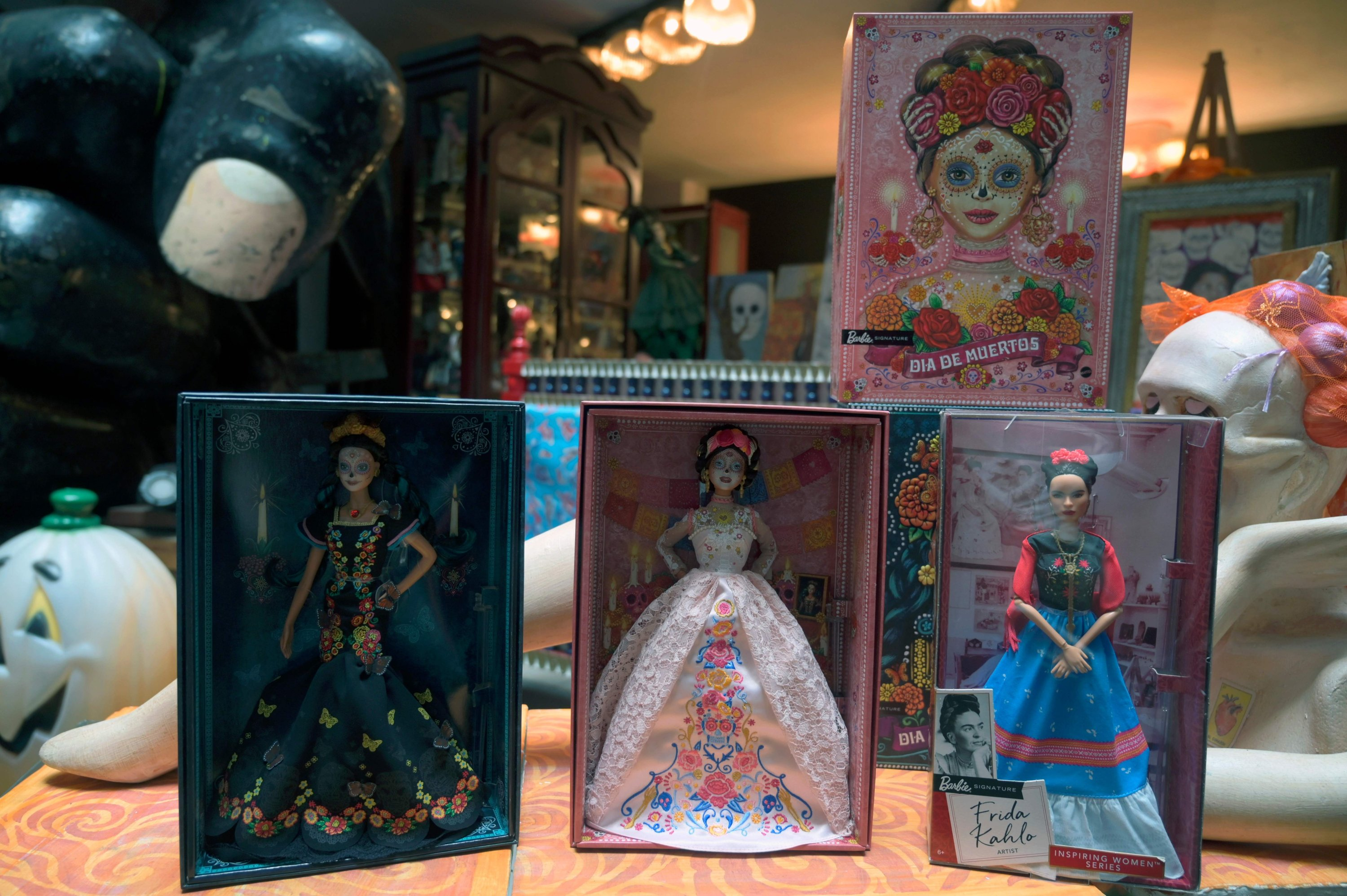 """View of two """"Catrina"""" Barbie dolls and a Frida Kahlo one at the Museum of the Old Mexican Toy in Mexico City, Oct. 20, 2020. (Photo by ALFREDO ESTRELLA / AFP)"""
