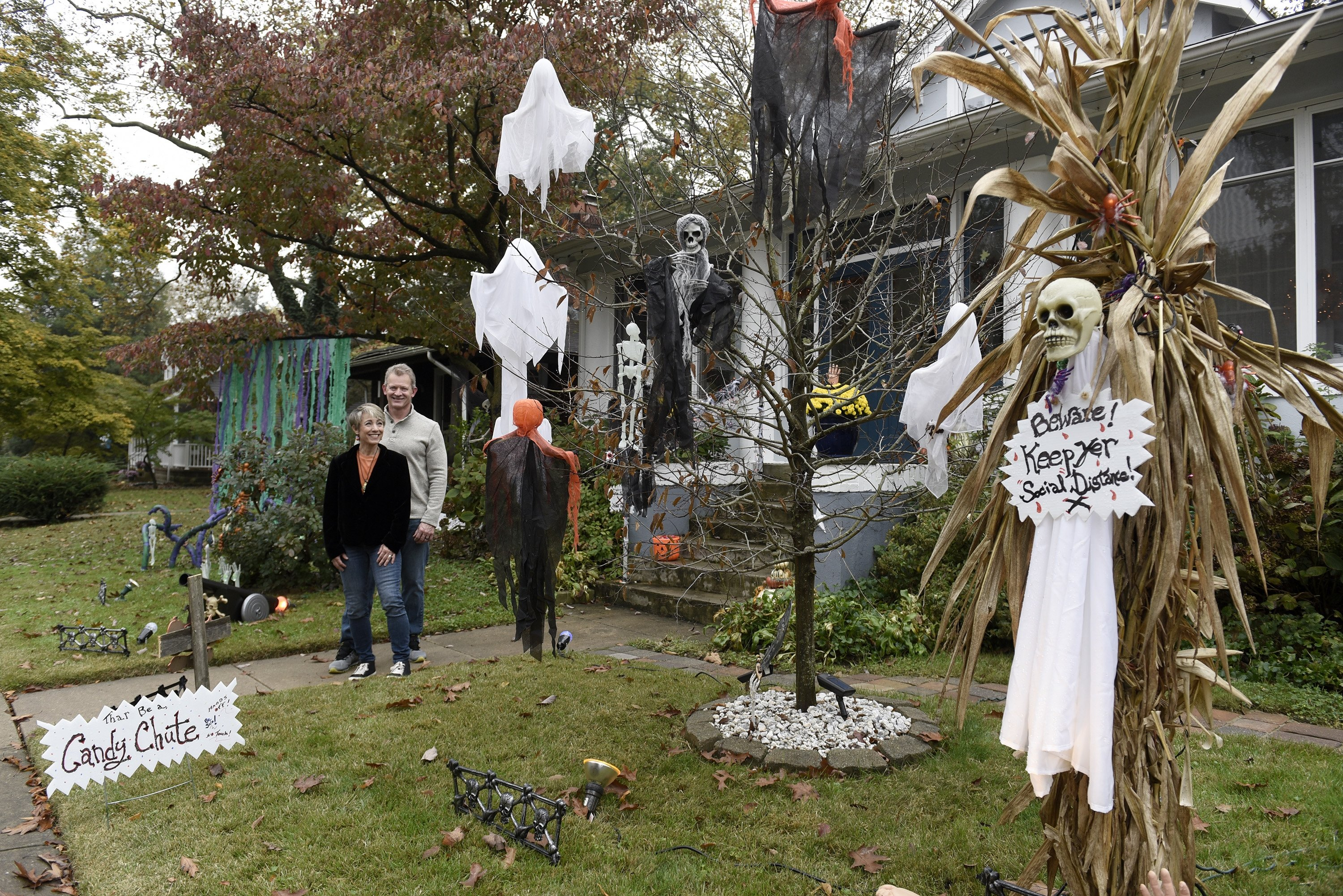 Carol McCarthy and her husband, Tom, pose for a portrait at their home they decorated for Halloween, Monday, Oct. 26, 2020, in Palmyra, N.J. (AP Photo)