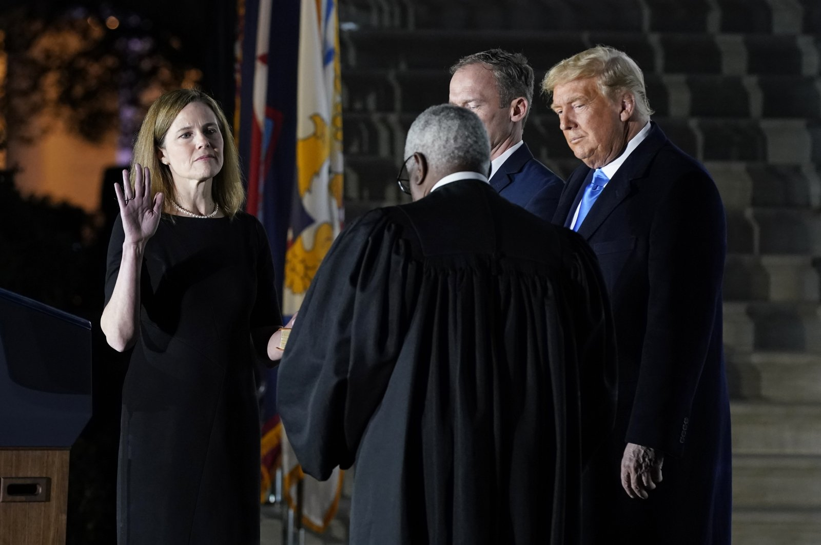 (From L to R) Amy Coney Barrett takes the Constitutional Oath administered by Supreme Court Justice Clarence Thomas. Jesse Barrett holds the Bible while President Donald Trump watches, on the South Lawn of the White House in Washington D.C., Oct. 26, 2020. (AP Photo)