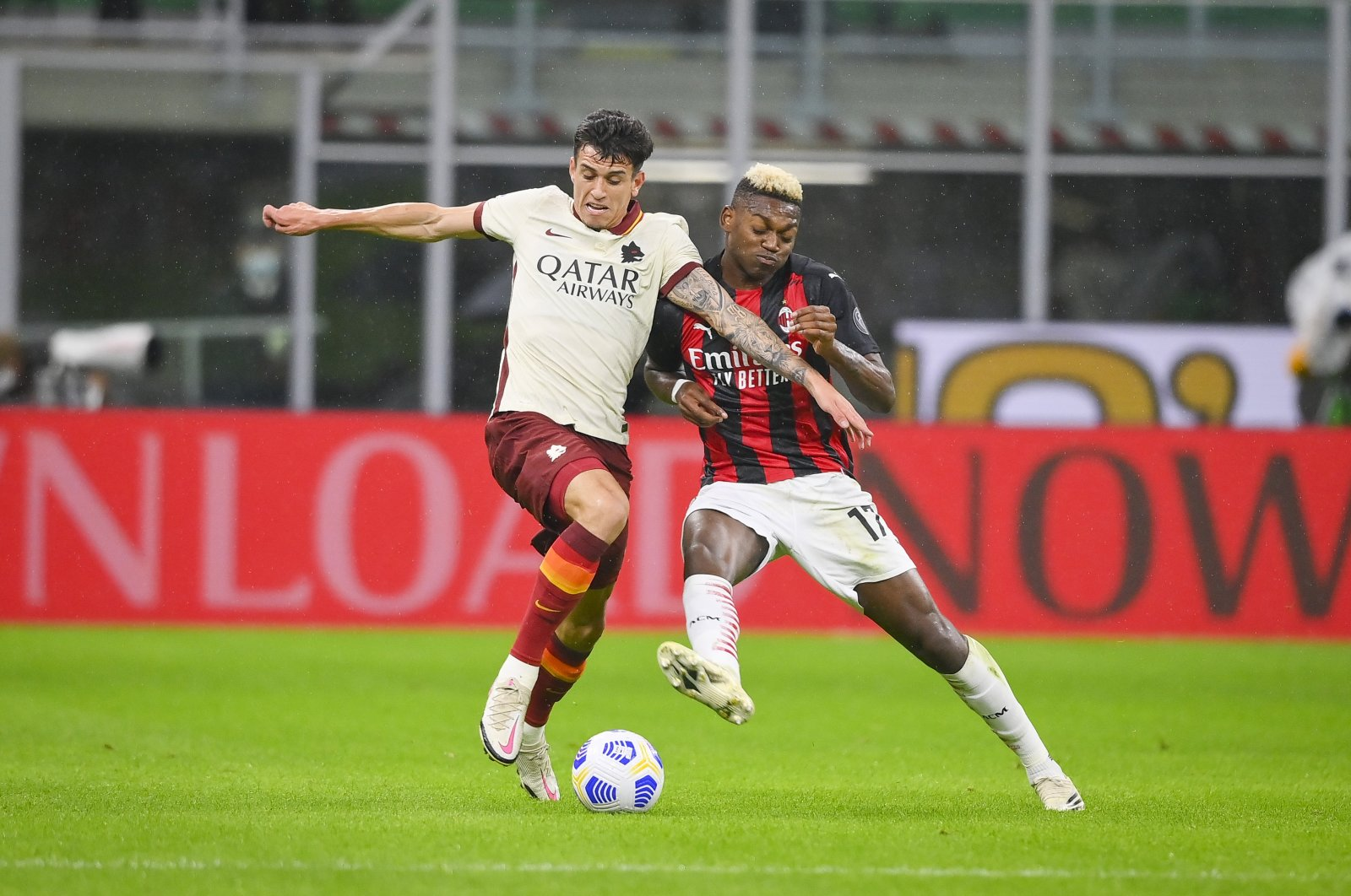 AC Milan's Rafael Leao (R) and Roma's Roger Ibanez vie for the ball during a Serie A match in Milan, Italy, Oct. 26, 2020. (AP Photo)