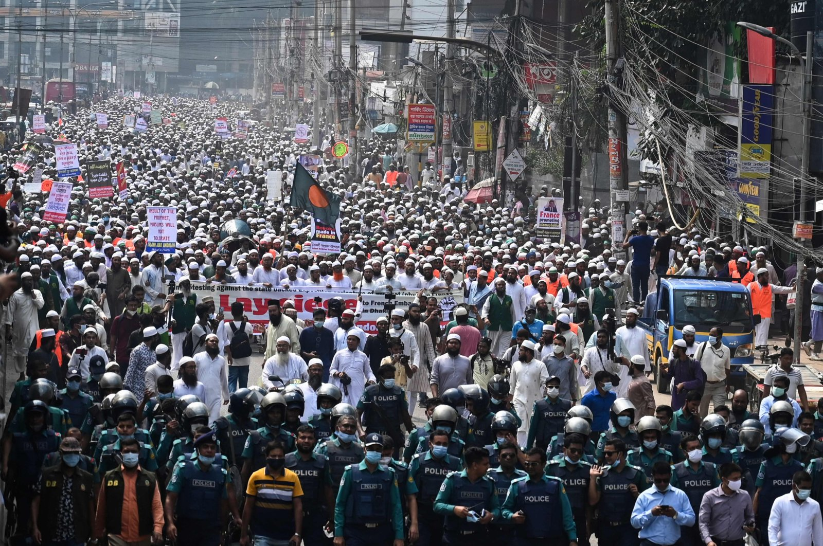 Protesters march to call for the boycott of French products and to denounce French president Emmanuel Macron for his comments over caricatures of the Prophet Muhammad in Dhaka, Bangladesh, Oct. 27, 2020. (AFP Photo)