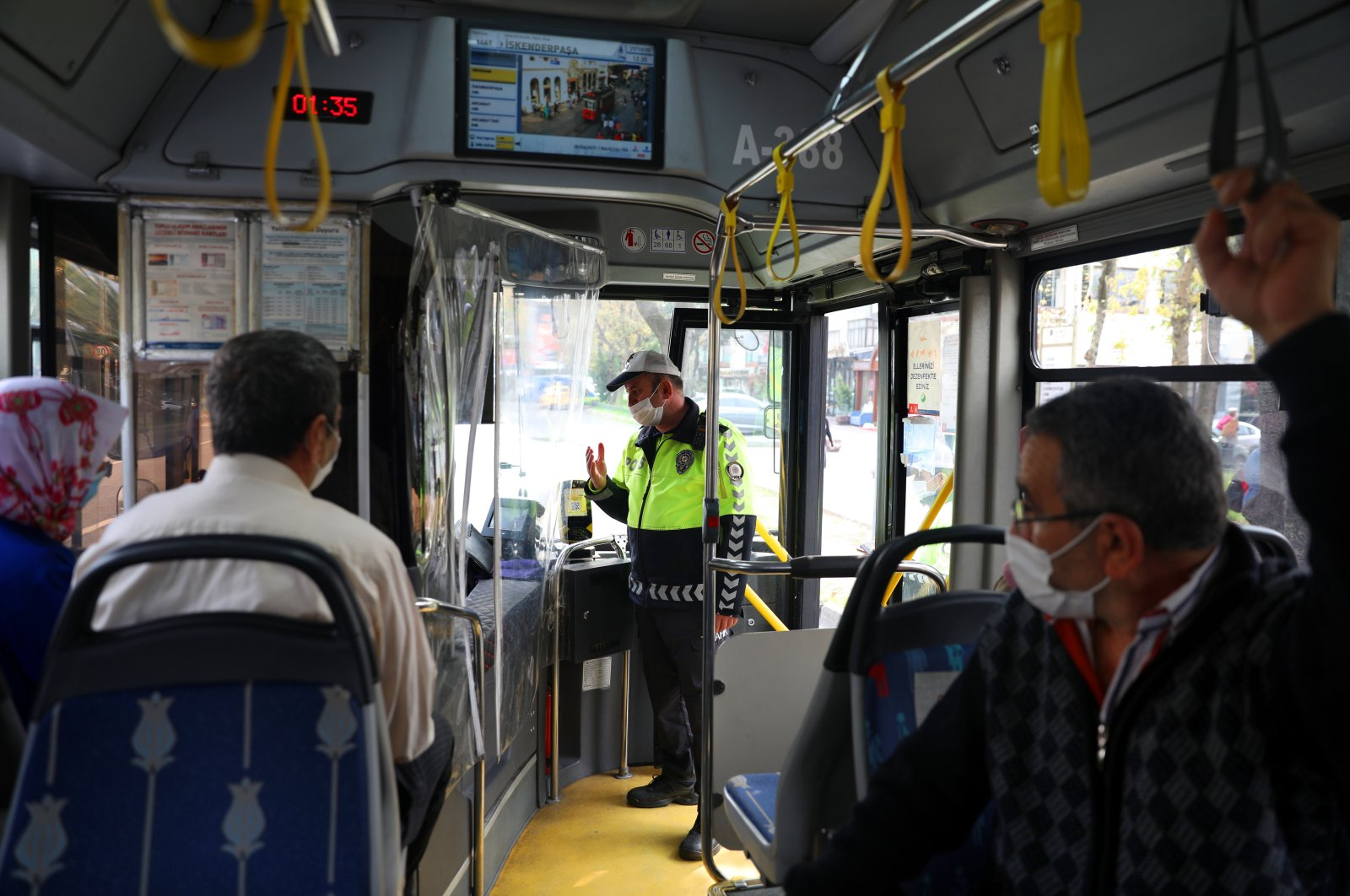 A policeman inspects a bus for compliance with COVID-19 measures, in Istanbul, Turkey, Oct. 27, 2020. (AA Photo)