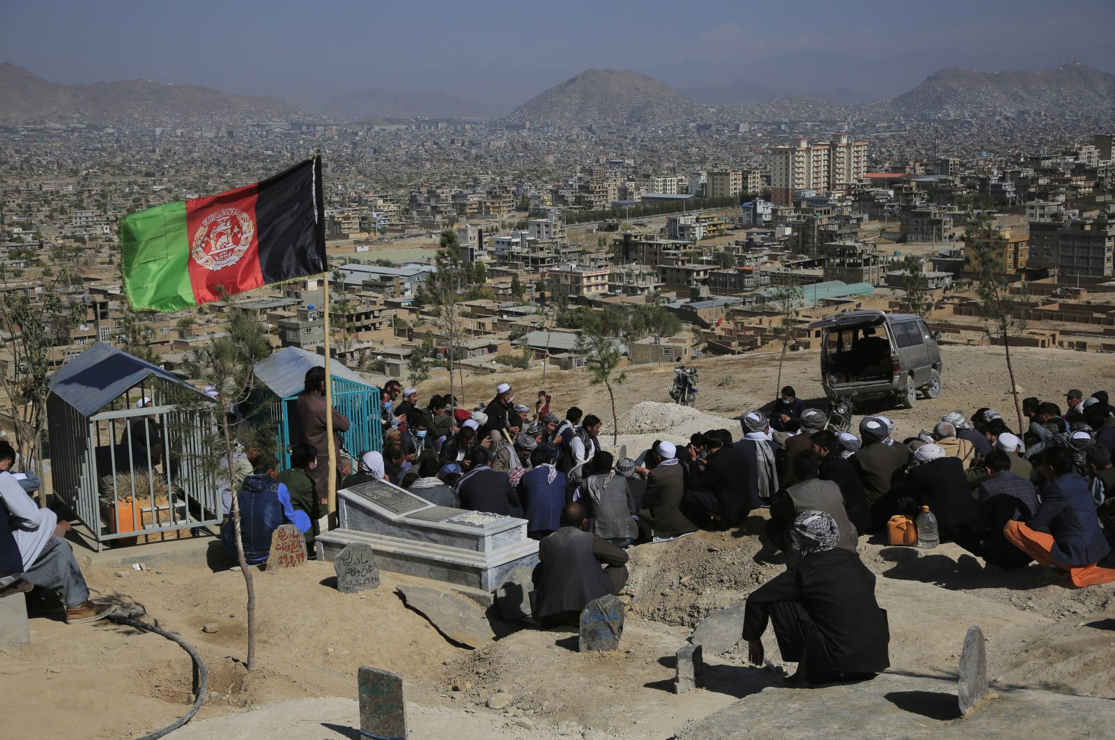 Afghan men bury a victim of Saturday's suicide attack that targeted an education center, in Kabul, Afghanistan, Oct. 25, 2020. (AP Photo)