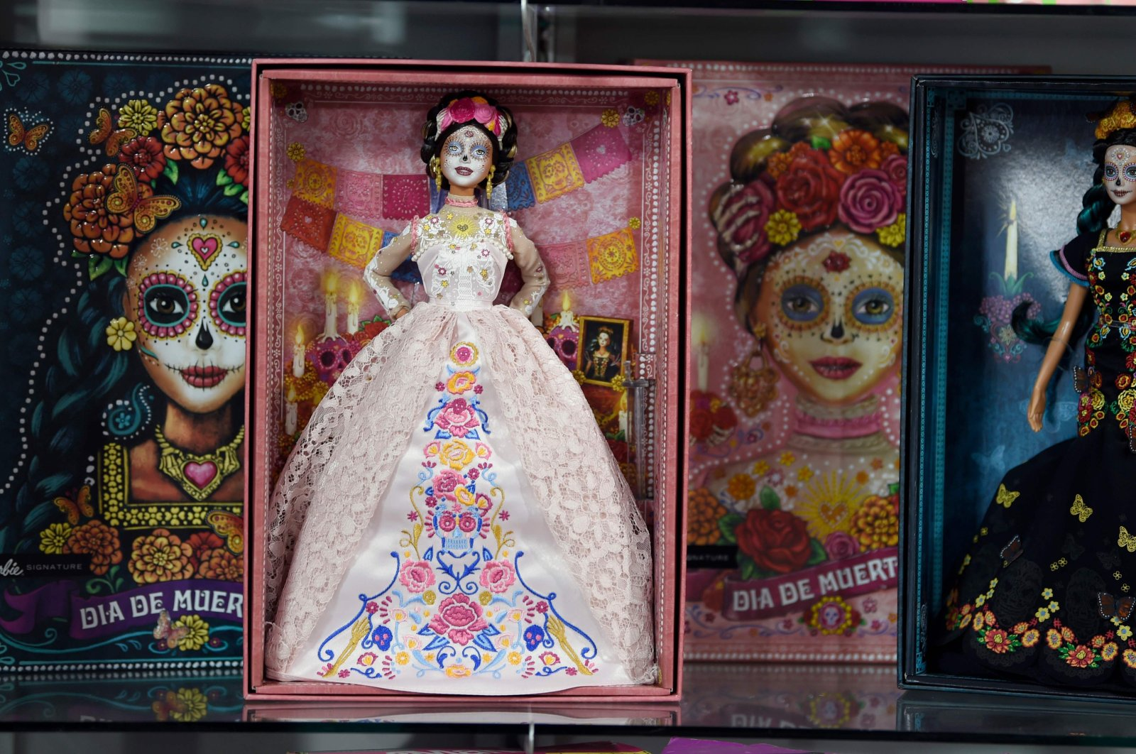 """View of two """"Catrina"""" Barbie dolls at the Museum of the Old Mexican Toy in Mexico City, Oct. 20, 2020. (AFP Photo)"""
