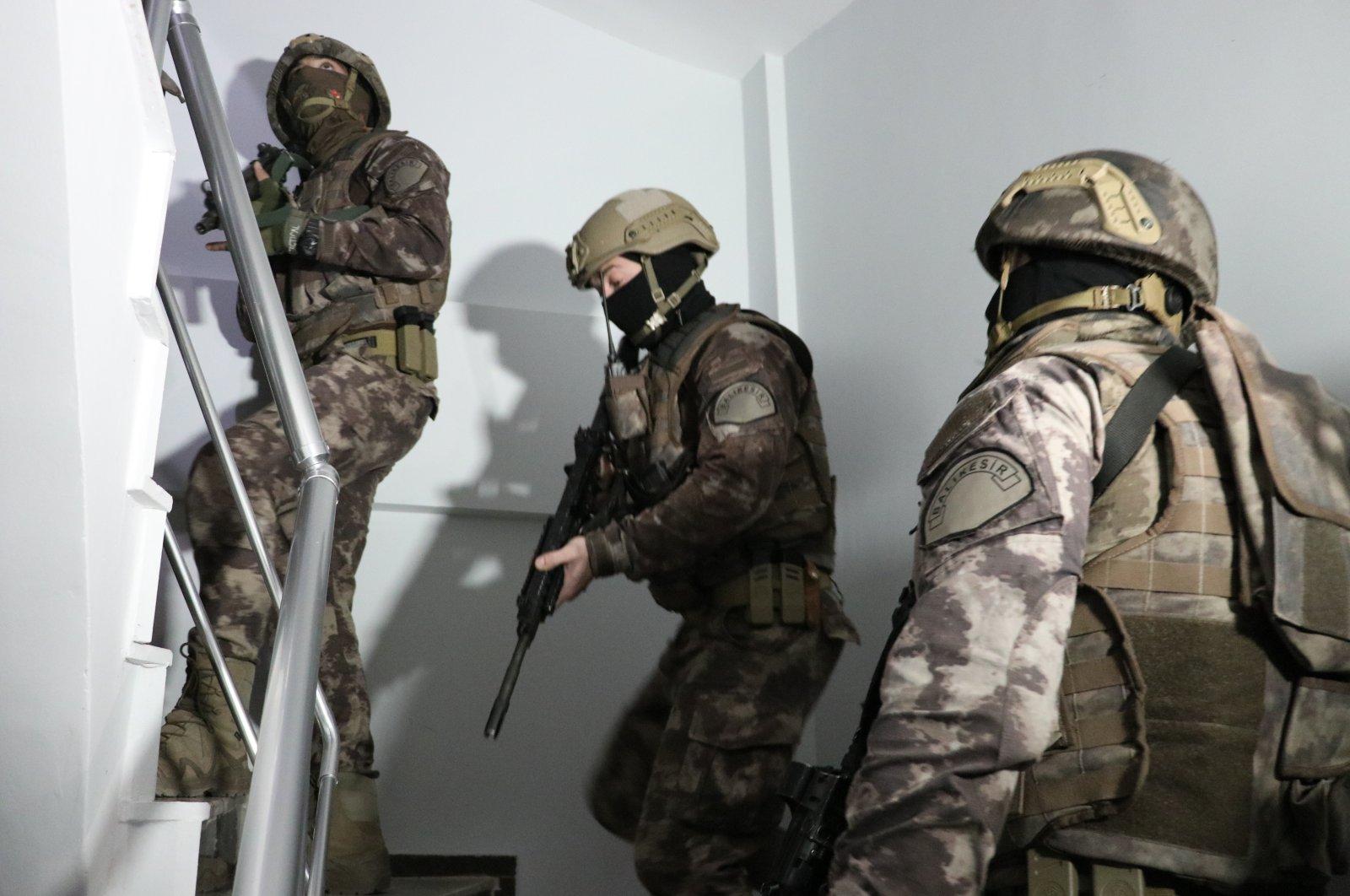 Police officers raid a FETÖ safehouse in Balıkesir, western Turkey, Oct. 27, 2020. (AA Photo)