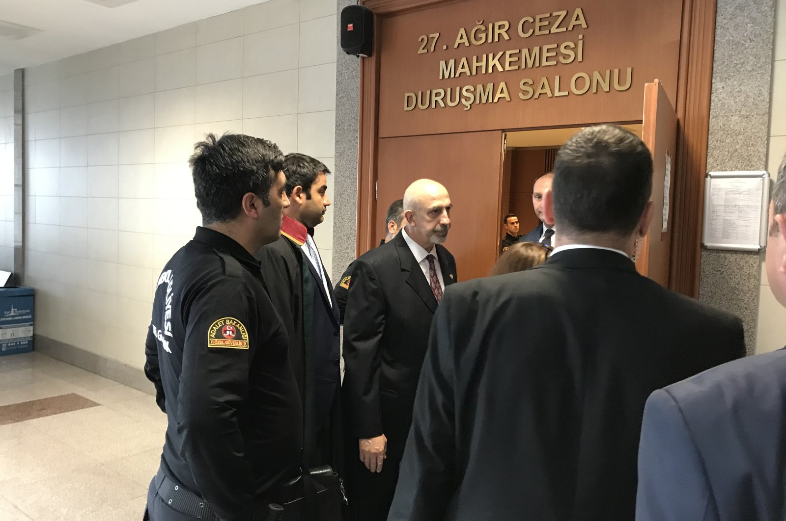 Nazmi Mete Cantürk (C) enters the courtroom for a hearing in Istanbul, Turkey, Oct. 2, 2019. (PHOTO BY FATİH ULAŞ)