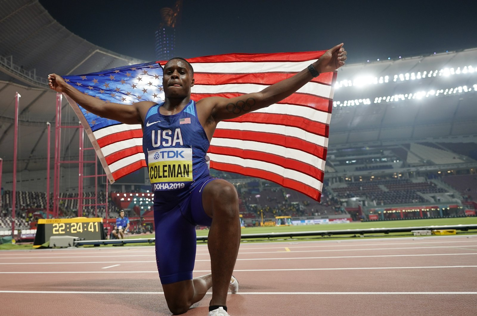 Christian Coleman, of the United States, celebrates winning the gold medal in the men's 100 meter final race at the World Athletics Championships in Doha, Qatar, Sept. 28, 2019. (AP Photo)