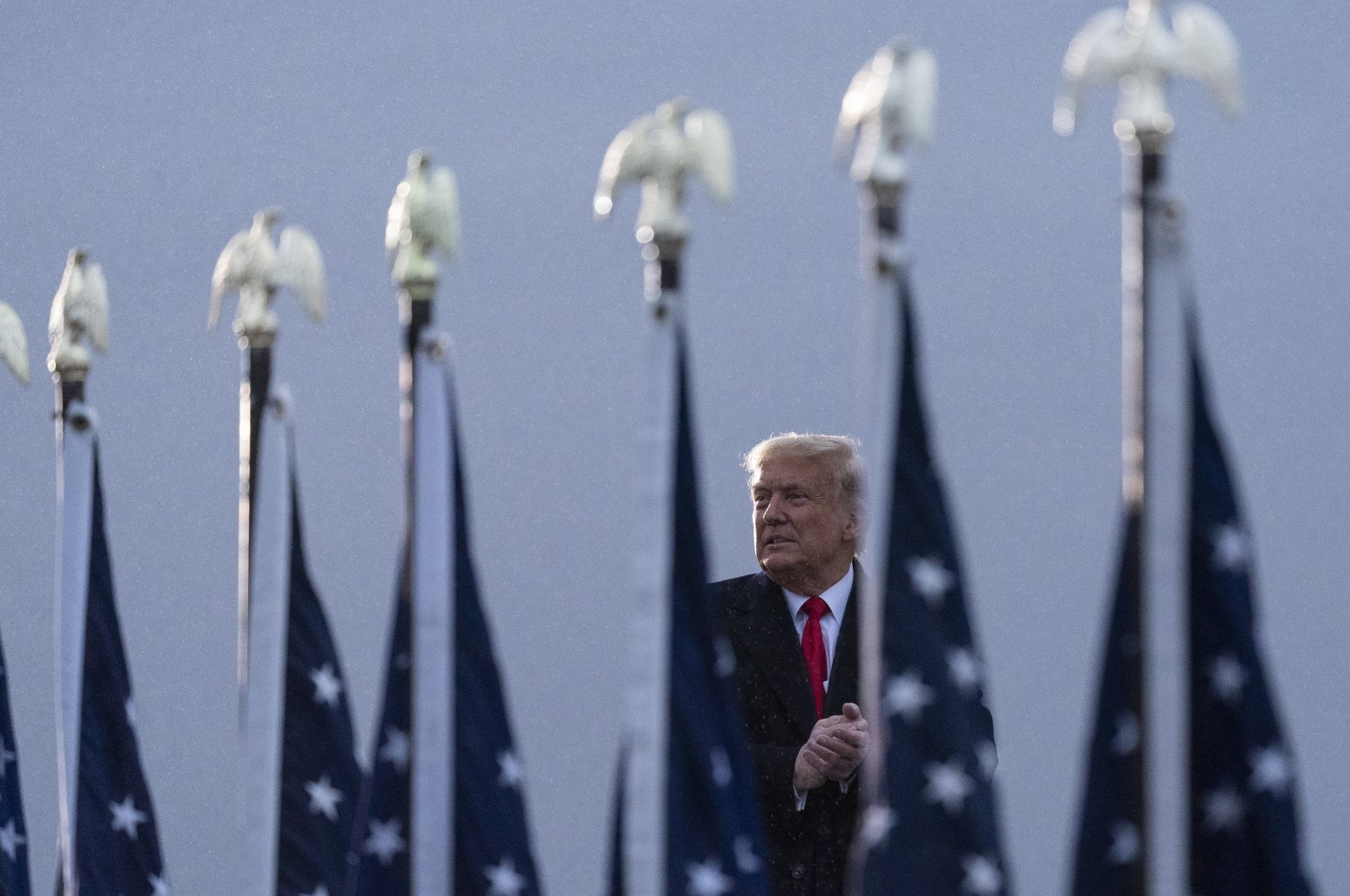 U.S. President Donald Trump applauds as he departs after speaking at a campaign rally at Altoona-Blair County Airport, in Martinsburg, Pennsylvania, Oct. 26, 2020. (AP Photo)
