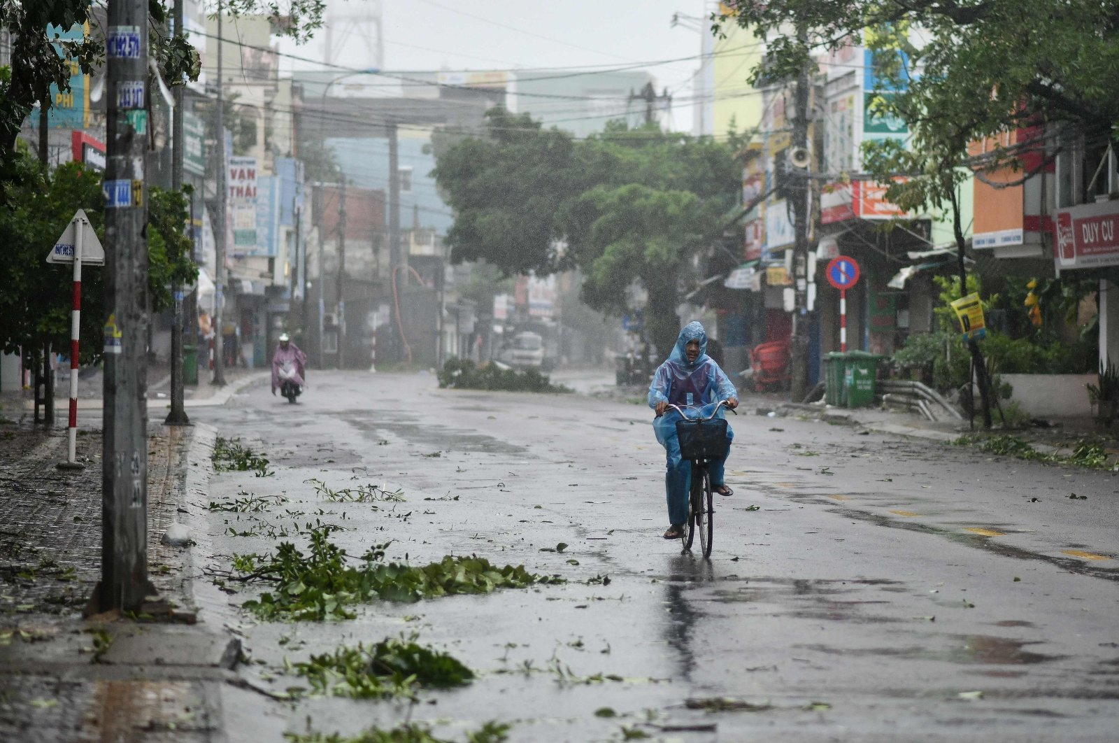 A man rides along a deserted road amid strong winds in central Vietnam's Quang Ngai province as Typhoon Molave makes landfall, on Oct. 28, 2020. (AFP Photo)