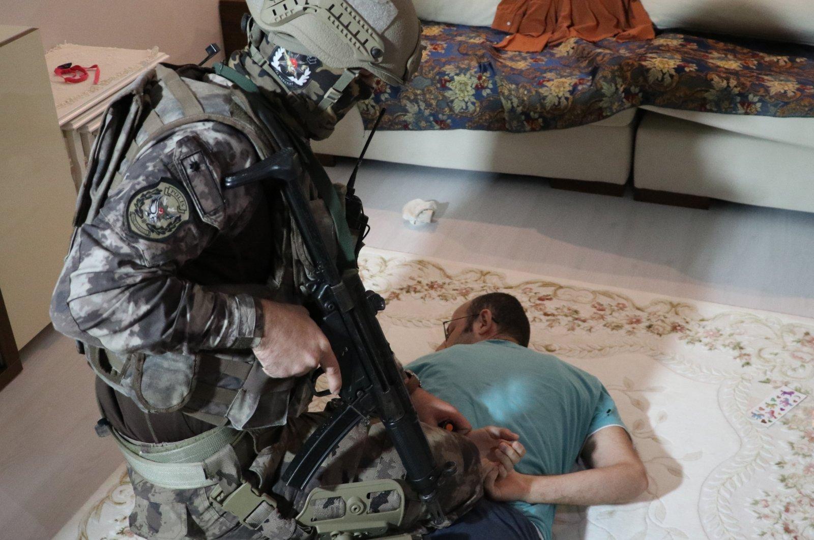 Security forces detain a FETÖ suspect in western Balıkesir province, Turkey, Oct. 27, 2020. (AA Photo)