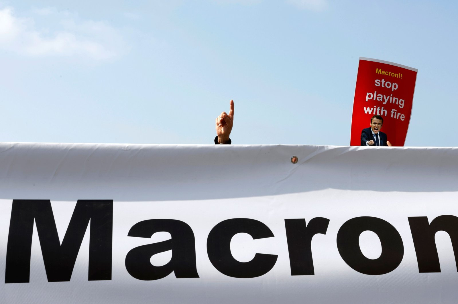 Arab-Israeli Muslim demonstrators gather near the French embassy in Israel's Mediterranean coastal city of Tel Aviv for a protest against comments by French President Emmanuel Macron defending cartoons of the Prophet Muhammed, on Oct. 27, 2020. (AFP Photo)