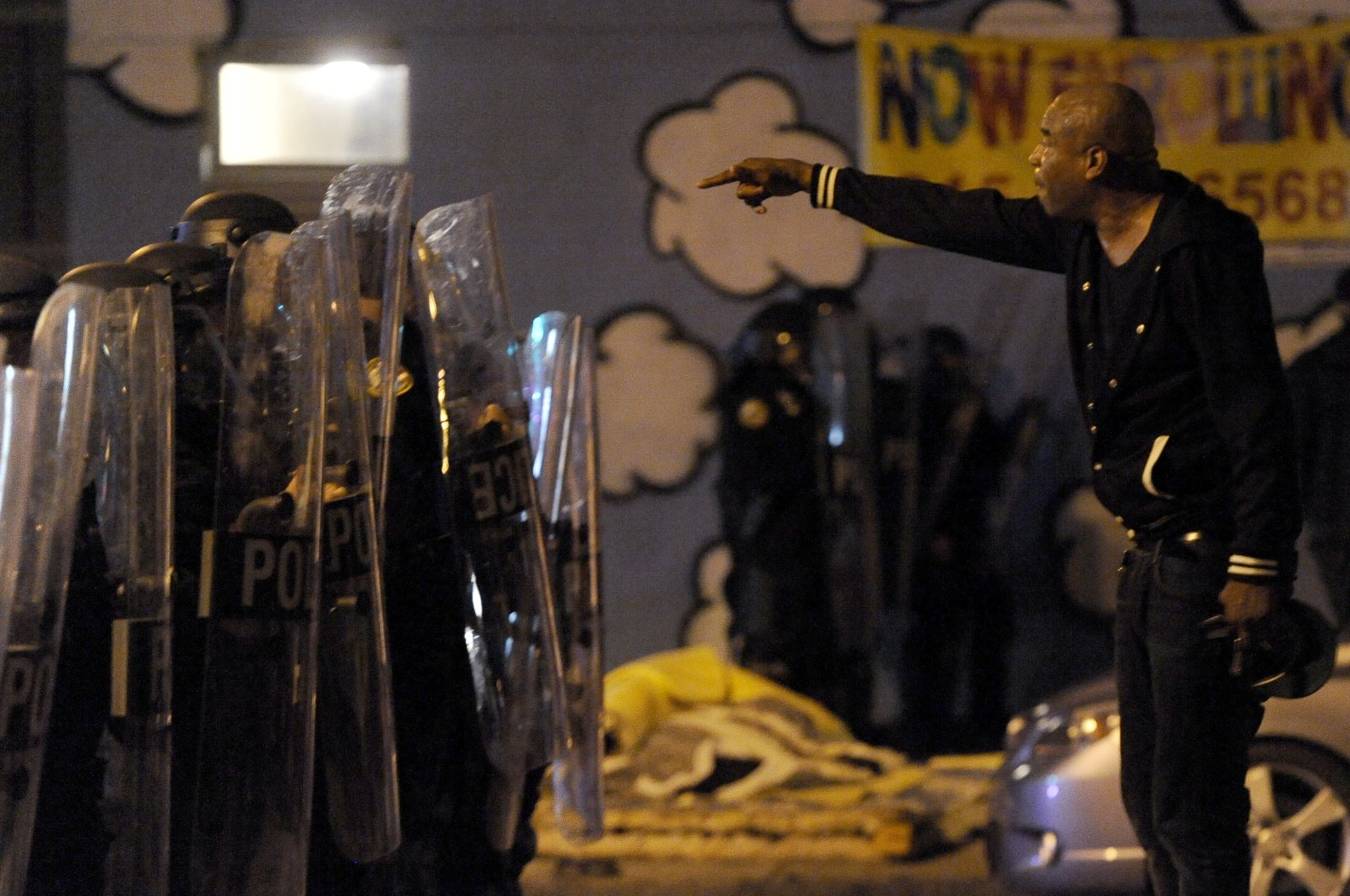 A protester points while facing police during a demonstration, in Philadelphia, U.S., Oct. 27, 2020. (AP Photo)