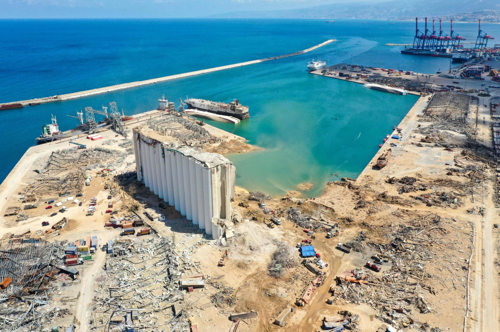 An aerial view of the port of Beirut, the damaged grain silo and the crater caused by the colossal explosion of a huge pile of ammonium nitrate that had languished for years in a port warehouse, leaving scores of people dead or injured and causing devastation in the Lebanese capital, Aug. 9, 2020. (AFP Photo)