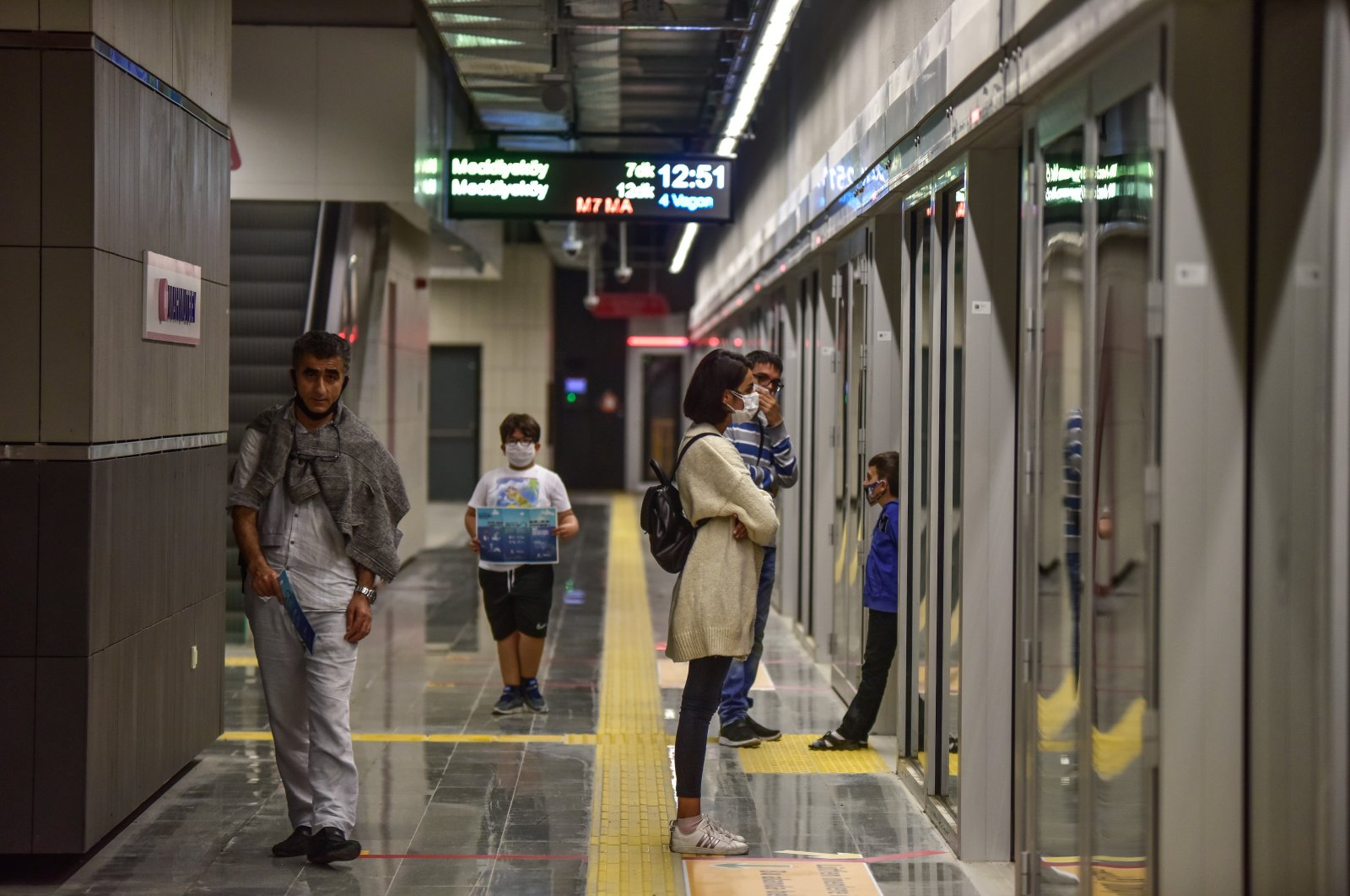 Passengers walk in a station of Mecidiyeköy-Mahmutbey metro line, Oct. 28, 2020. (DHA Photo)