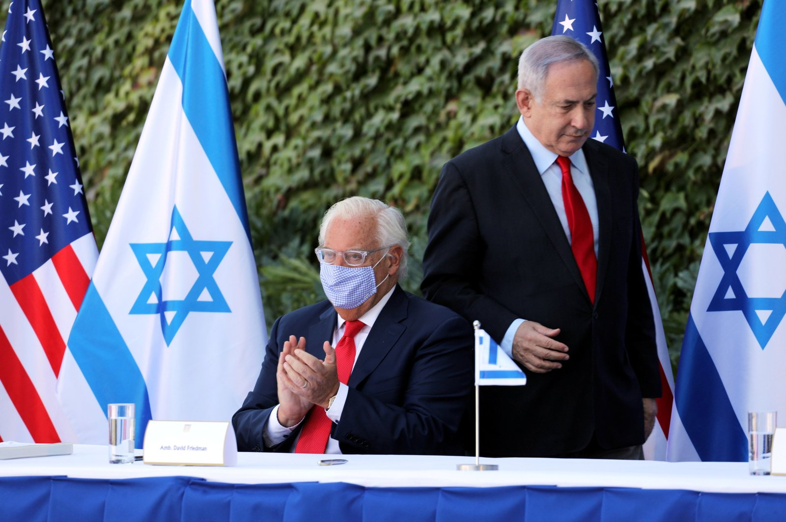 Israeli Prime Minister Benjamin Netanyahu and the U.S. Ambassador to Israel David Friedman attend a special ceremony to sign an extension of the Israel-U.S. scientific cooperation agreement at Ariel University in the Jewish settlement of Ariel, in the Israeli-occupied West Bank, Oct. 28, 2020. (Reuters Photo)