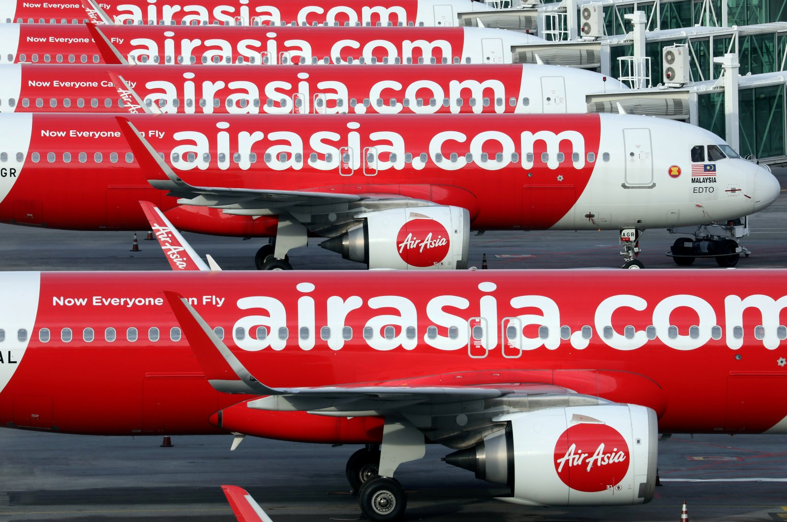 AirAsia planes are parked at Kuala Lumpur International Airport 2, in Sepang, Malaysia, Oct. 6, 2020. (Reuters Photo)