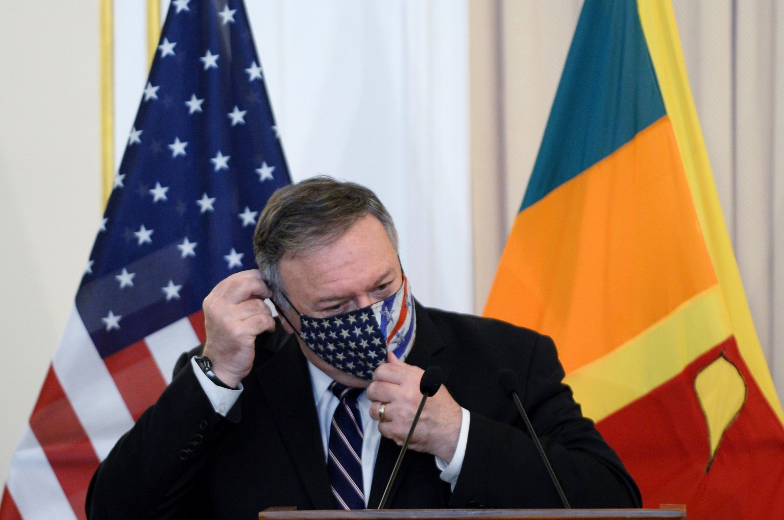 U.S. Secretary of State Mike Pompeo adjusts his facemask during a joint press briefing with Sri Lankan Foreign Minister Dinesh Gunawardena (not pictured) at the Ministry of Foreign Relations in Colombo, Oct. 28, 2020. (AFP Photo)