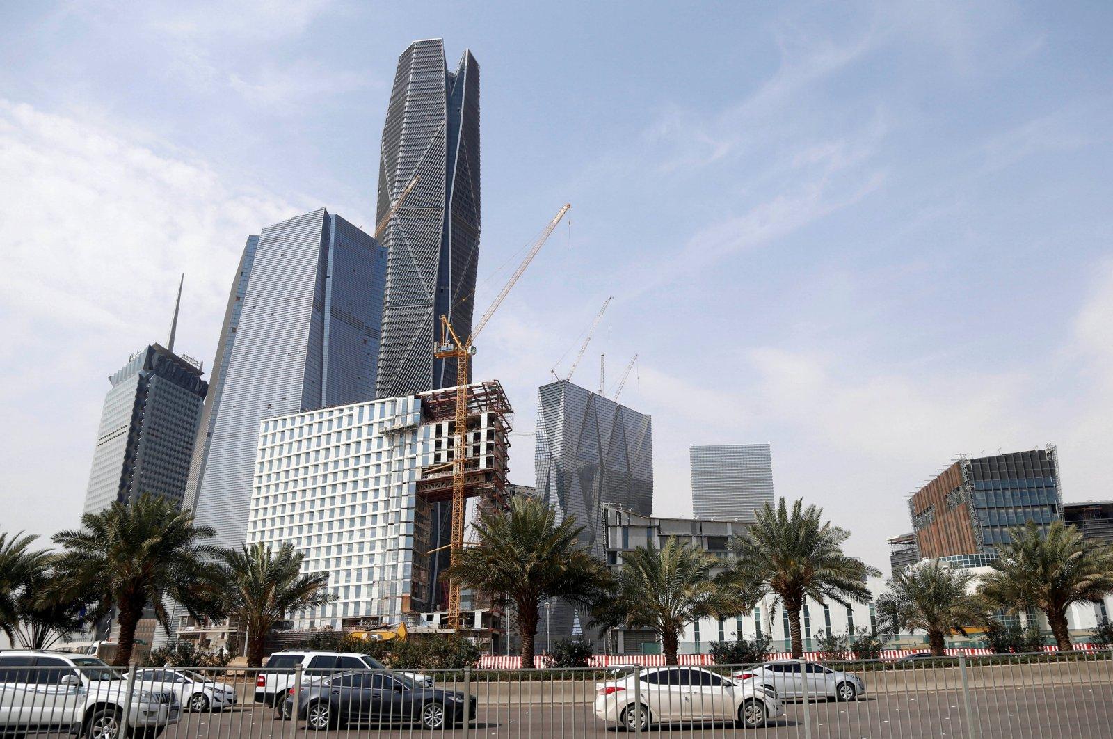 Cars drive past the King Abdullah Financial District, north of Riyadh, Saudi Arabia, March 1, 2017. (Reuters Photo)