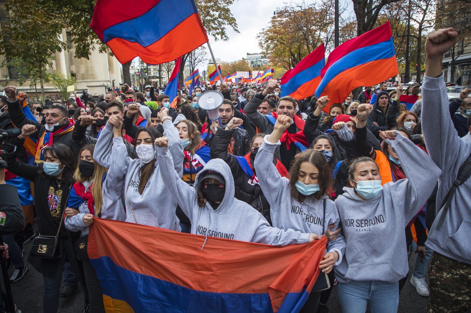 French-Armenian protesters hold Armenian flags as they shout slogans against Turkey during a demonstration supporting Armenia in Nagorno-Karabakh conflict in Paris, France, 25 October 2020. (EPA Photo)