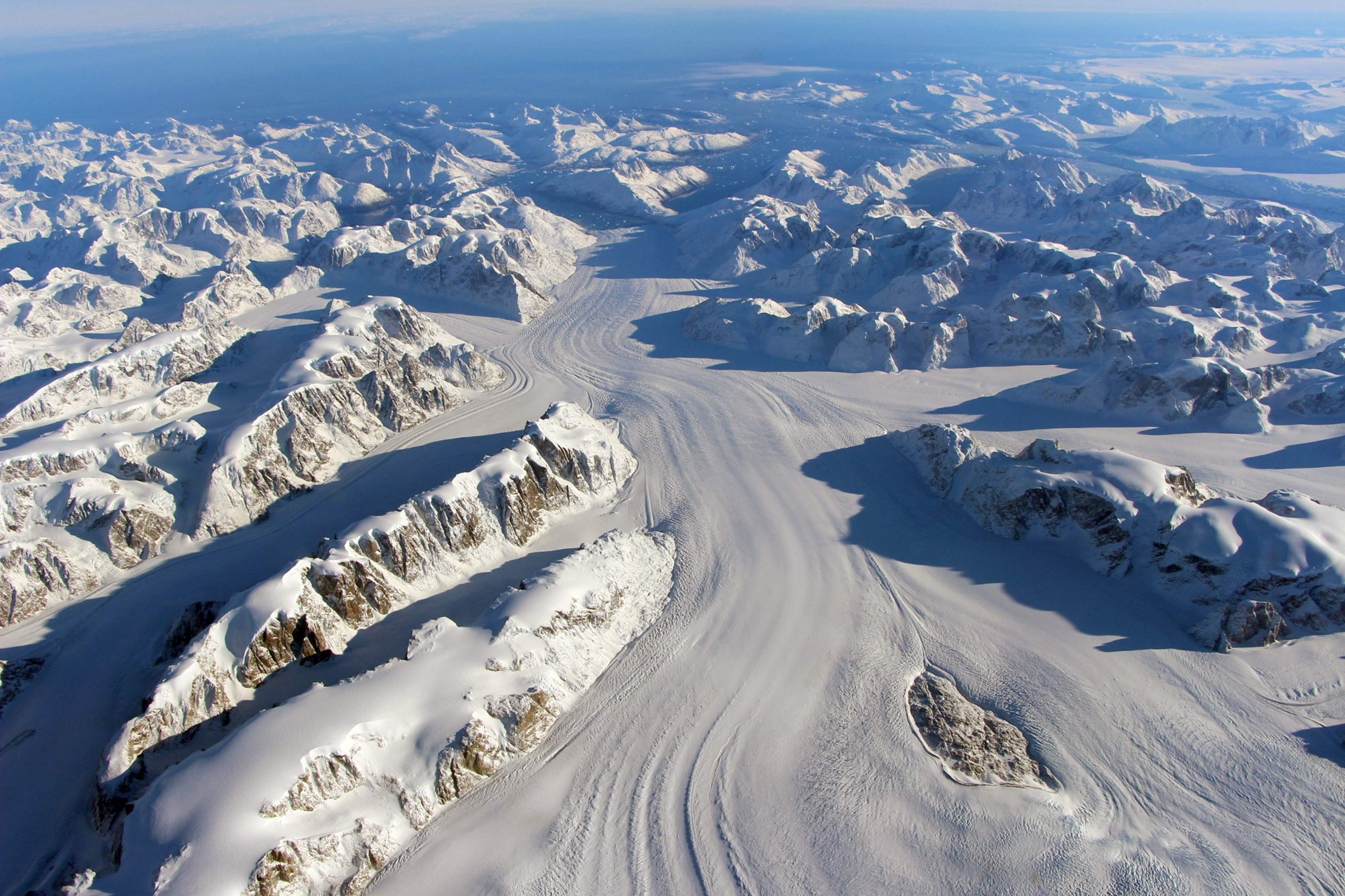 This file photo taken on October 13, 2015 and obtained on November 24, 2015 by NASA shows the Heimdal Glacier in southern Greenland, captured from NASA Langley Research Center's Falcon 20 aircraft flying 33,000 feet above mean sea level during NASA's Operation IceBridge, an airborne survey of polar ice. (AFP Photo)