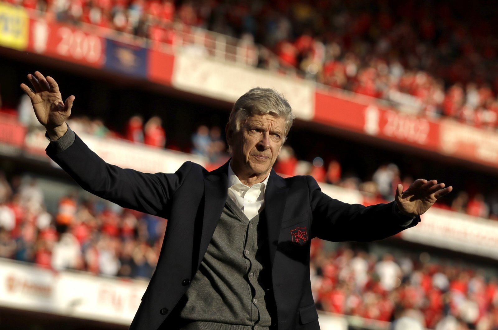 Former Arsenal manager Arsene Wenger waves after his last match with the club, London, Britain, May 6, 2018. (AP Photo)