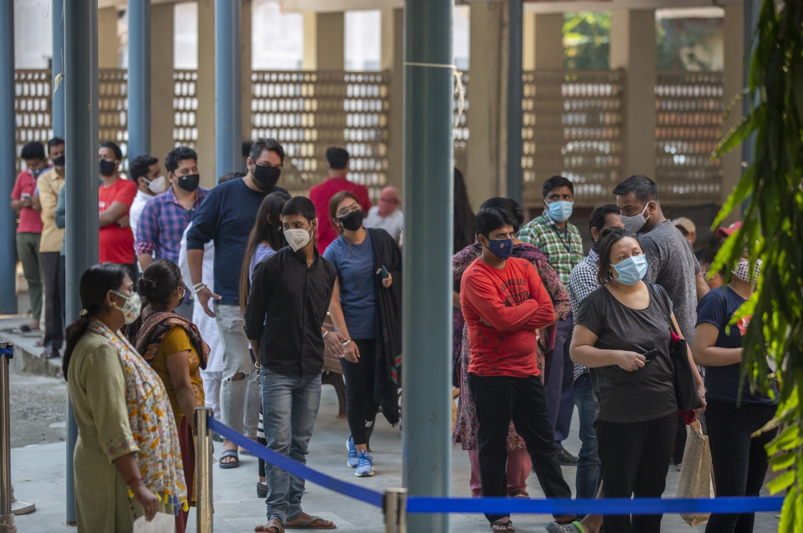 People wait for their turn at a COVID-19 testing center in New Delhi, India, Oct. 29, 2020. (AP Photo)