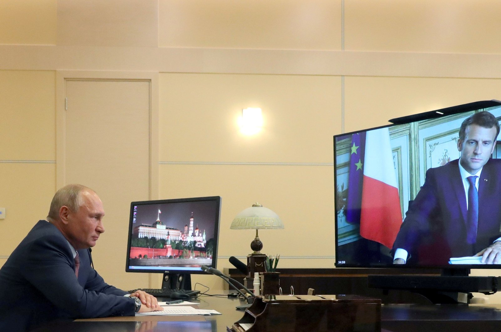 Russian President Vladimir Putin speaks with his French counterpart Emmanuel Macron during a video conference call at the Novo-Ogaryovo state residence outside Moscow, Russia, June 26, 2020. (Reuters Photo)