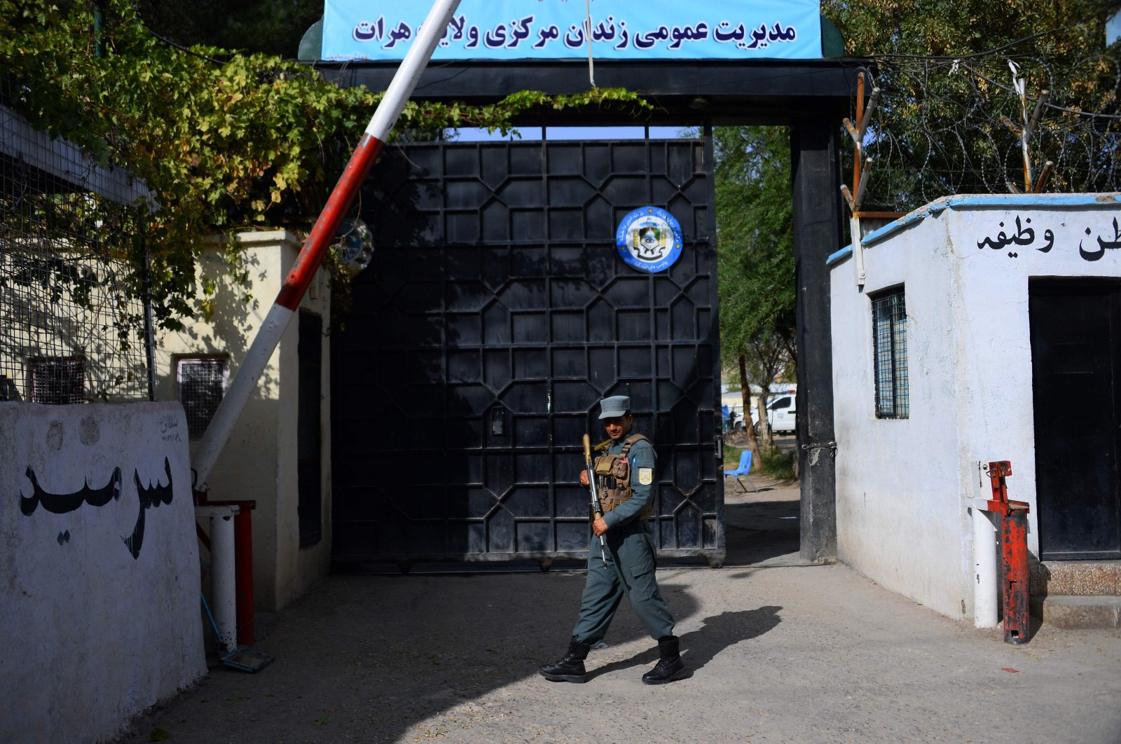An Afghan policeman stands guard at an entrance gate of a prison, Herat, Afghanistan, Oct. 29, 2020. (AFP Photo)