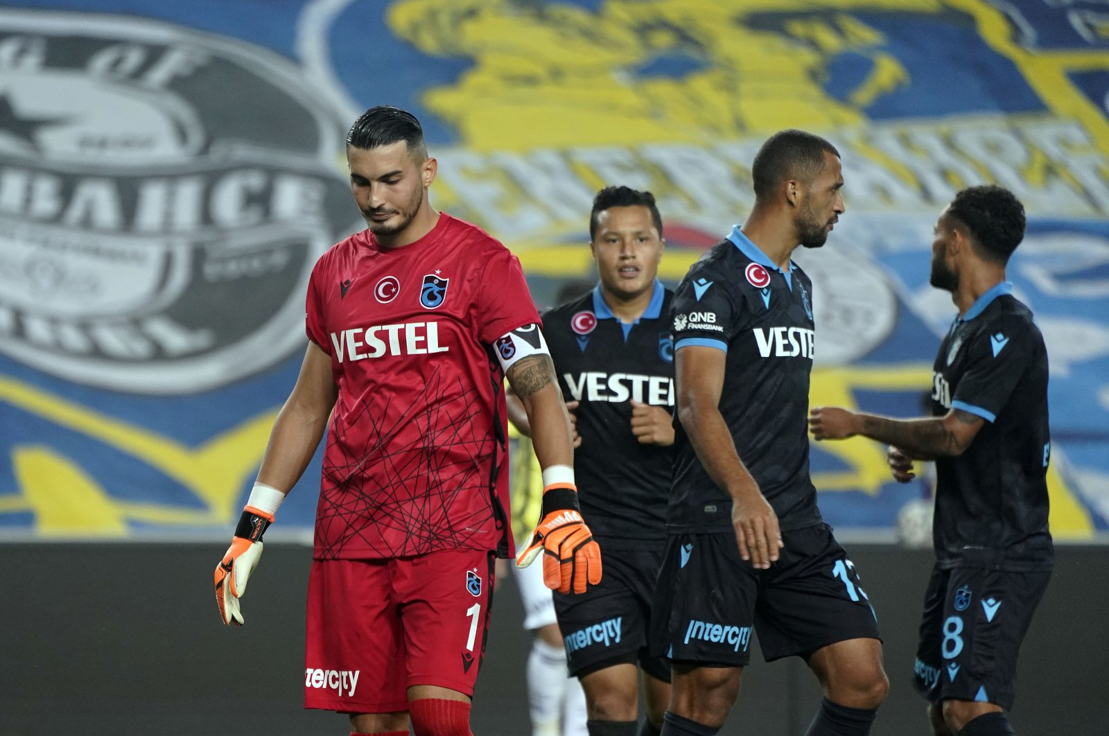 Trabzonspor goalkeeper Uğurcan Çakır (L) looks dejected after the Süper Lig match against Fenerbahçe, in Istanbul, Turkey, Oct. 25, 2020. (IHA Photo)