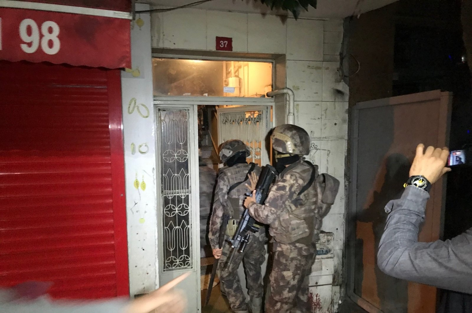 Police raid a house during operations against the DHKP-C in Istanbul, Turkey, Oct. 29, 2020. (İHA Photo)
