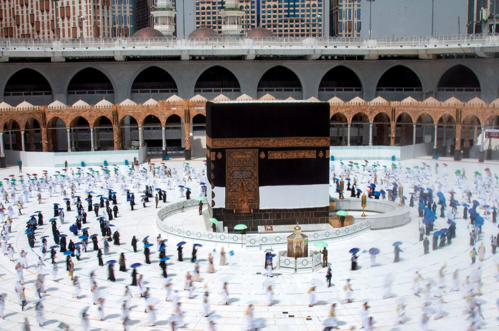 Muslim pilgrims maintain social distancing as they circle the Kaaba at the Grand Mosque during the annual Haj pilgrimage amid the COVID-19 pandemic, in the holy city of Mecca, Saudi Arabia, July 29, 2020. (Saudi Ministry of Media/Handout via Reuters)