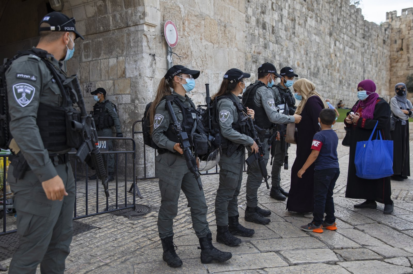 Israeli border police officers check identification cards of Palestinians as they make their way to the Al Aqsa Mosque compound to mark the birthday of the Prophet Mohammed, in Jerusalem's old city, Oct. 29, 2020. (AP Photo)