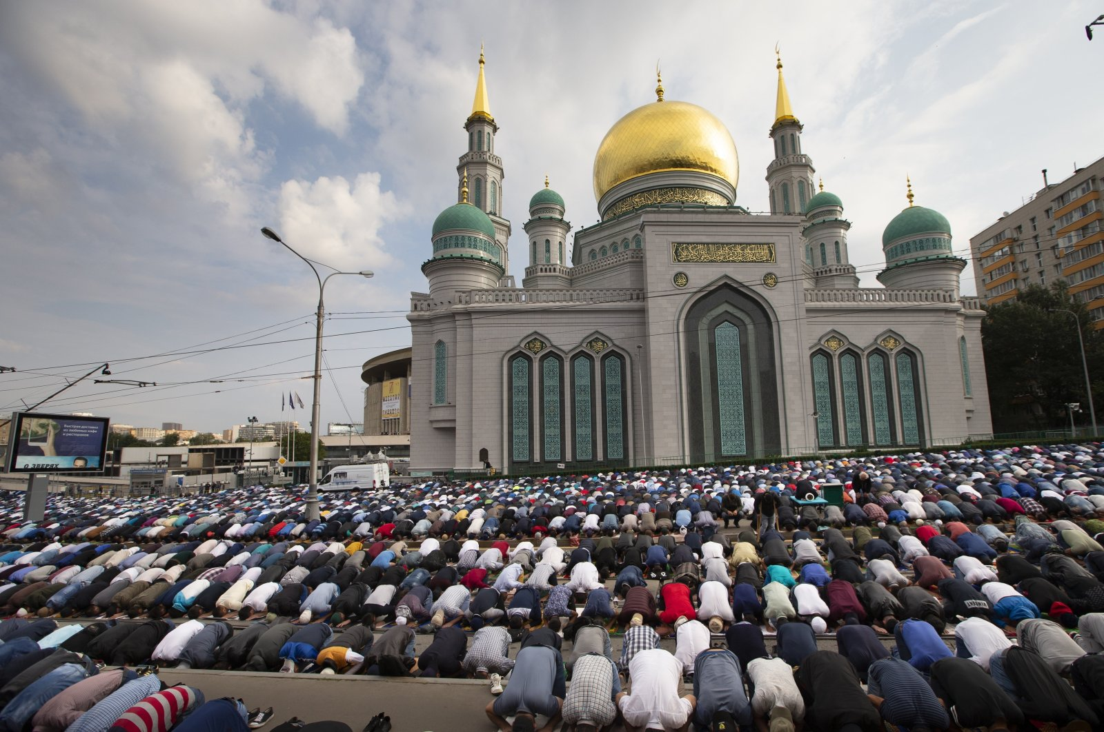 Muslims pray outside the Moscow Cathedral Mosque during celebrations of Eid al-Adha, a feast celebrated by Muslims worldwide, in Moscow, Russia, Aug. 21, 2018. (AP Photo)