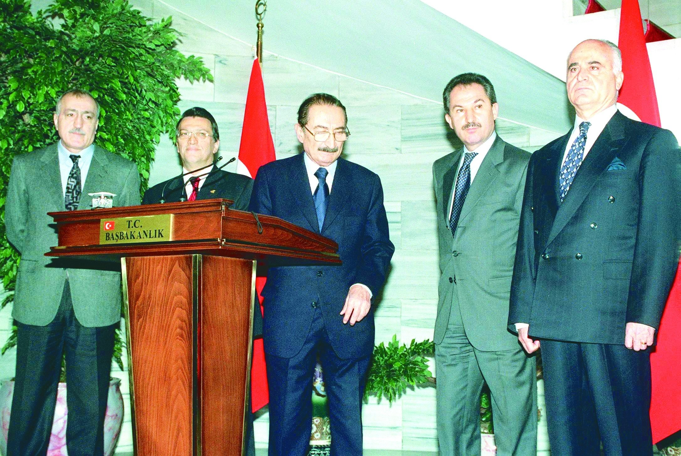 This file photo dated Feb. 20, 2001 shows Prime Minister Bülent Ecevit (C), accompanied by Deputy Prime Minister Mesut Yılmaz (2nd L), Deputy Prime Minister Hüsamettin Özkan of DSP (2nd R), Interior Minister Saadettin Tantan of ANAP (L), and Defense Minister Sabahattin Çakmakoğlu (R), leaving a press conference at the Prime Ministry in Ankara after a contentious National Security Council (MGK) meeting. (AA Photo) Following a heated discussion between Ecevit, Özkan and President Sezer at the MGK meeting in violation of long established state protocols over the Presidency's involvement in corruption probes, which included Sezer and Özkan throwing a booklet of constitution back and forth, led to an abrupt end of the meeting. In the following press conference, Ecevit described the row as an 'unprecedented state crisis' and publicly accused Sezer of misusing his powers and disrespect towards himself and the members of his cabinet. His words led a long-brewing financial collapse the next day known as the 2001 Turkish financial crisis. Yılmaz, visibly nervous in the photo, remarked later years that he did not expect Ecevit, who was vocally angry after the meeting, to make such a statement at the time and would use a rather conciliatory tone.