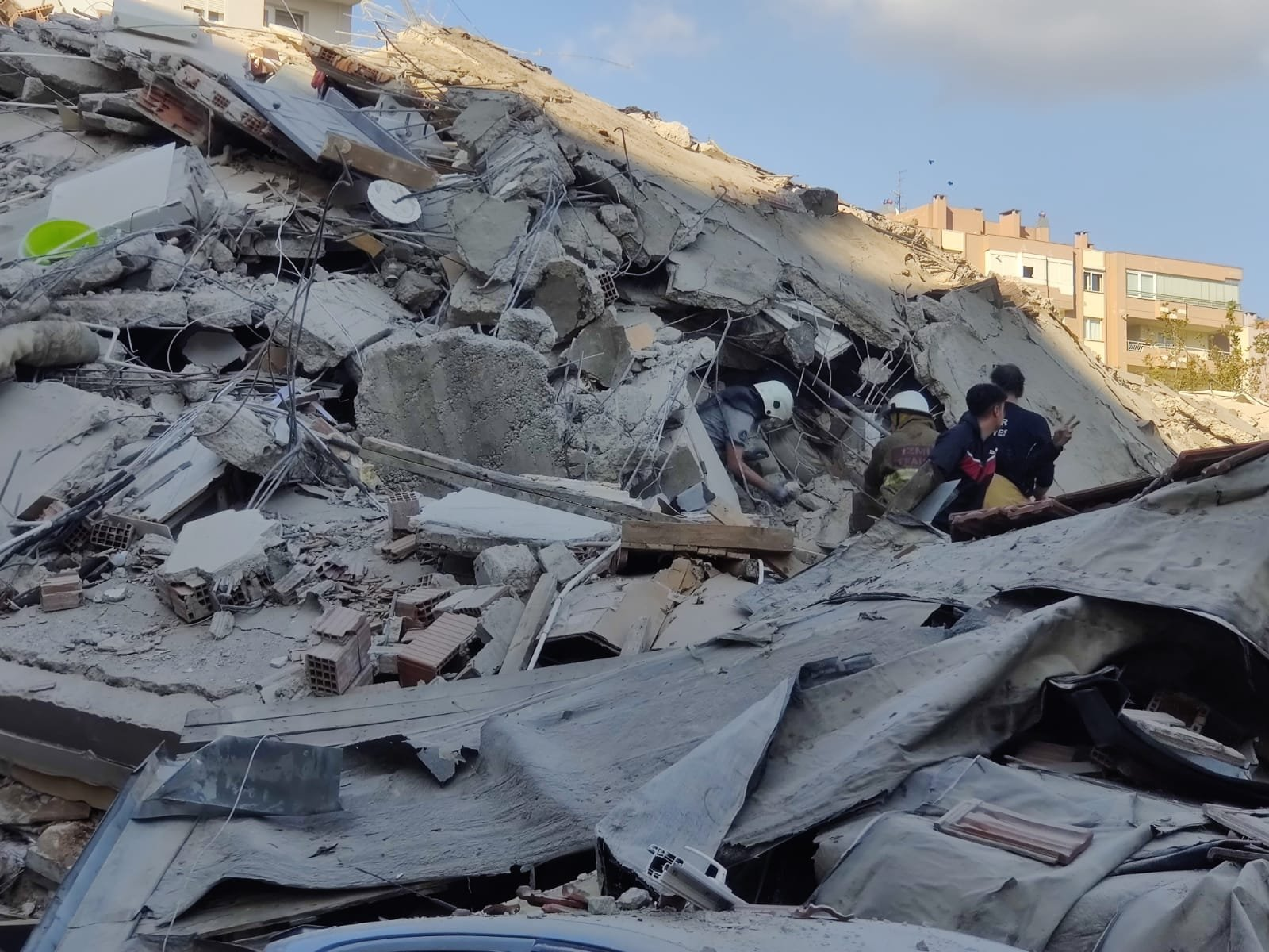 Search and rescue workers check the debris of a collapsed building in Izmir, western Turkey, Oct. 30, 2020. (AA Photo)