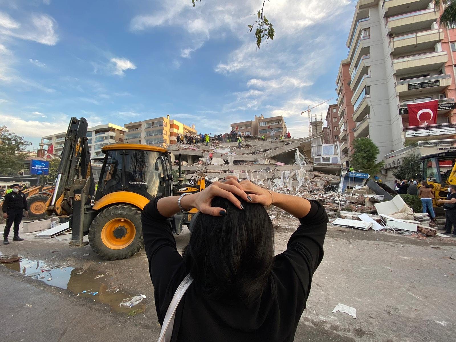A woman looks at the rubble of a building, in Izmir, western Turkey, Oct. 30, 2020. (AA Photo)