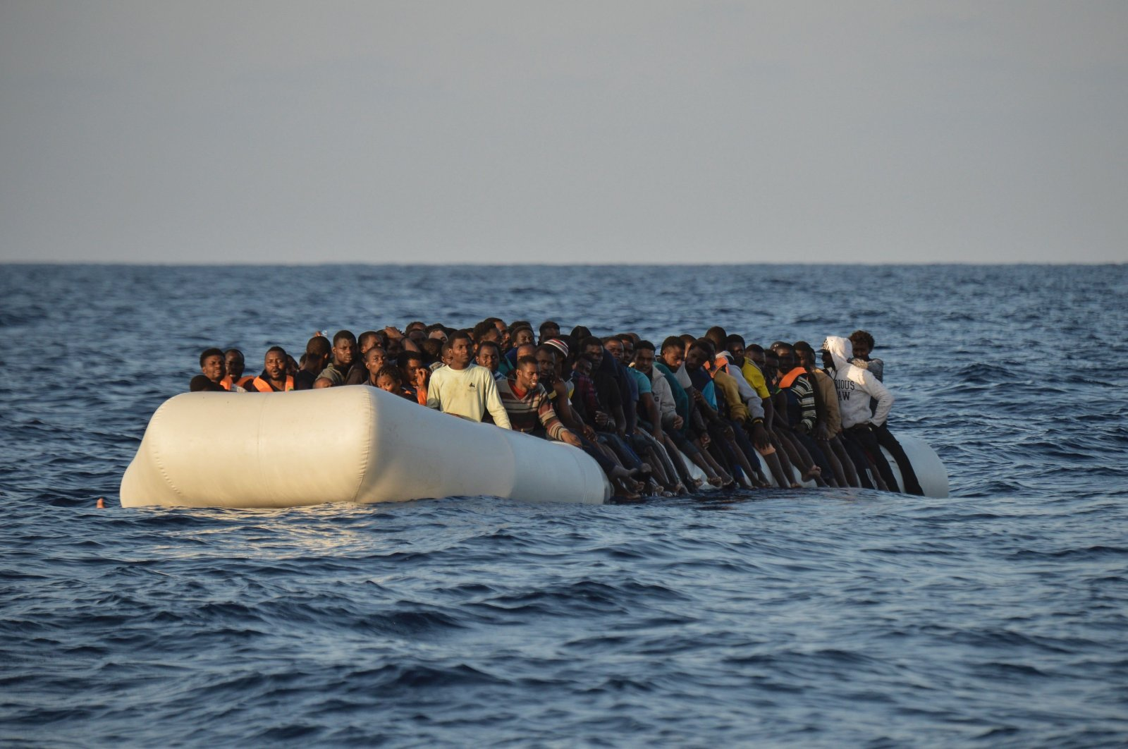 Migrants and refugees on a rubber boat before to be rescued by the ship Topaz Responder run by Maltese NGO Moas and the Red Cross, off the Libyan coast in the  Mediterranean Sea, on Nov. 3, 2016. (AFP Photo)