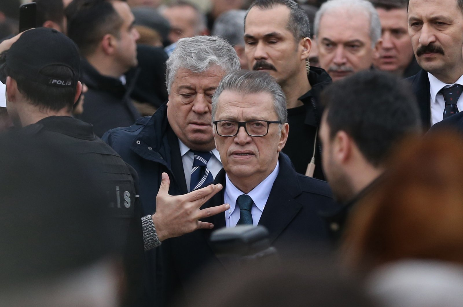 Former Prime Minister Mesut Yılmaz (C) attends the funeral of his son Yavuz at a mosque in Istanbul, Turkey, Dec. 18, 2017. (AA Photo)