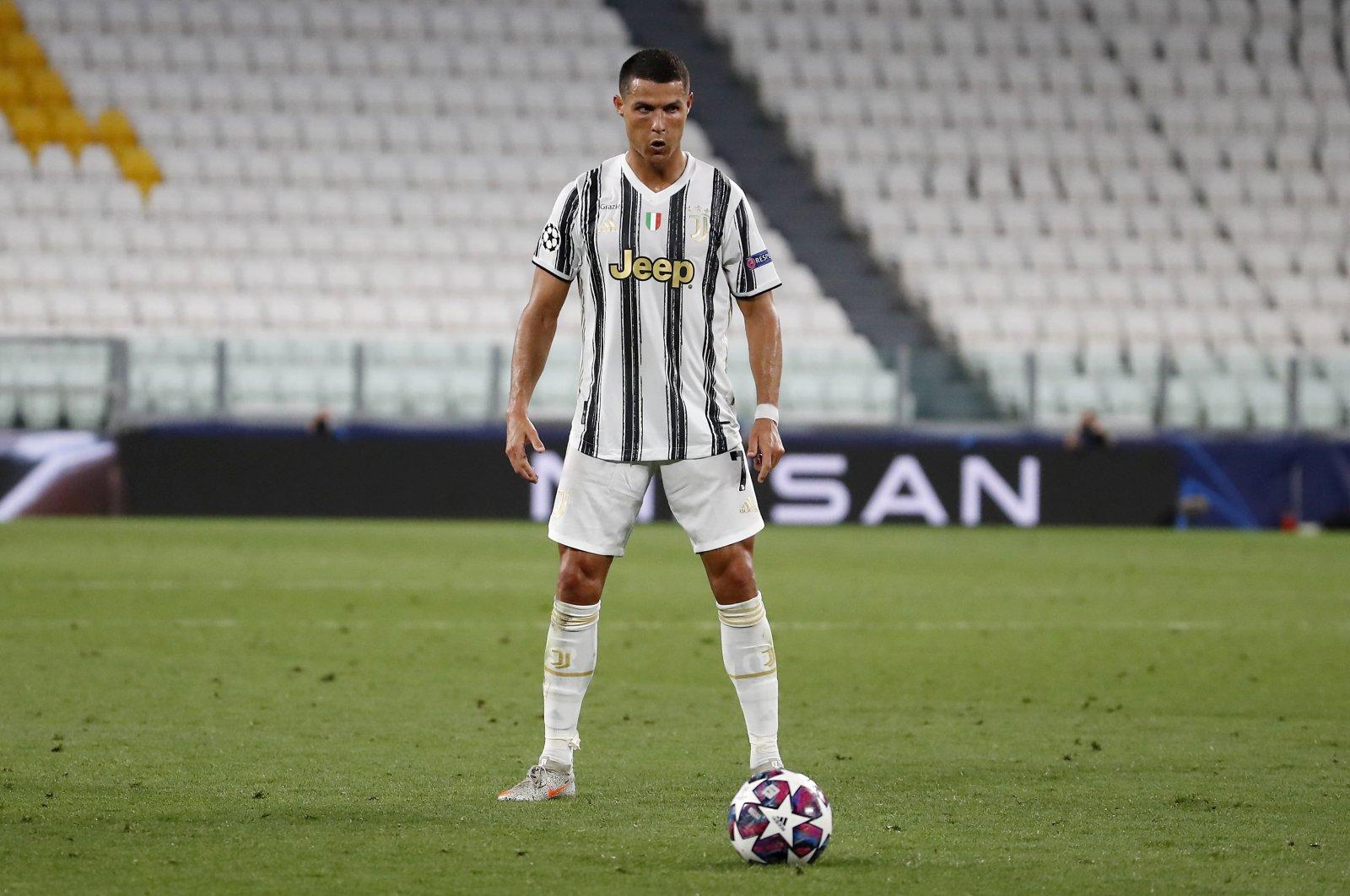 Juventus' Cristiano Ronaldo prepares to take a free kick during a Champions match against Lyon, in Turin, Italy, Aug. 7, 2020. (AP Photo)