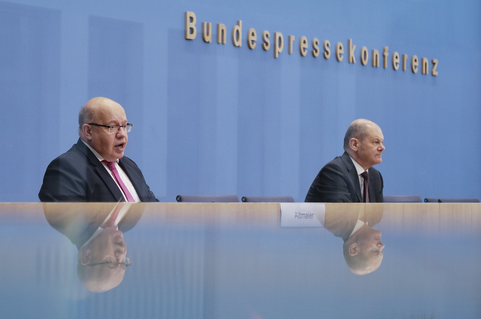 German Finance Minister Olaf Scholz (R) and German Economy Minister Peter Altmaier brief the media during a news conference about financial support for the German economy during the coronavirus crises in Berlin, Germany, Thursday, Oct. 29, 2020. (AP Photo)